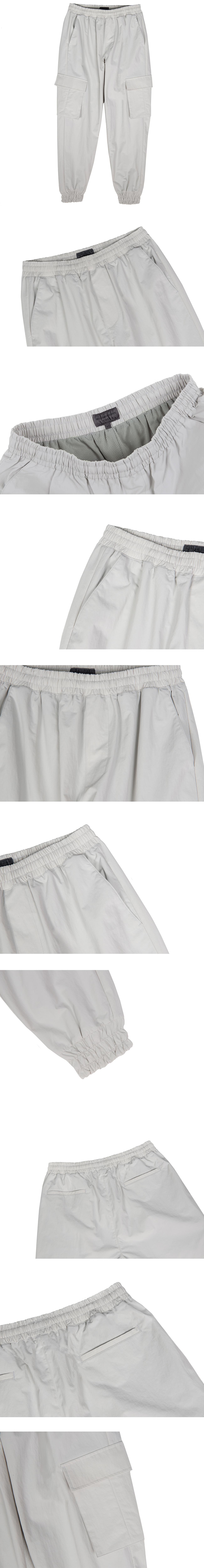 커스텀어클락(COSTUME O'CLOCK) 에센셜 나일론 카고포켓 조거 팬츠 라이트그레이